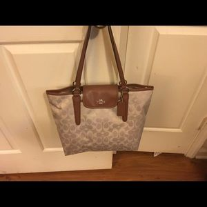 Brand new Coach bag with price tag.